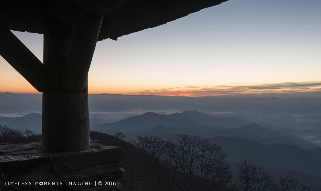 The sun peaks out from the mountains in the east - Wayah Bald Tower - Franklin, NC