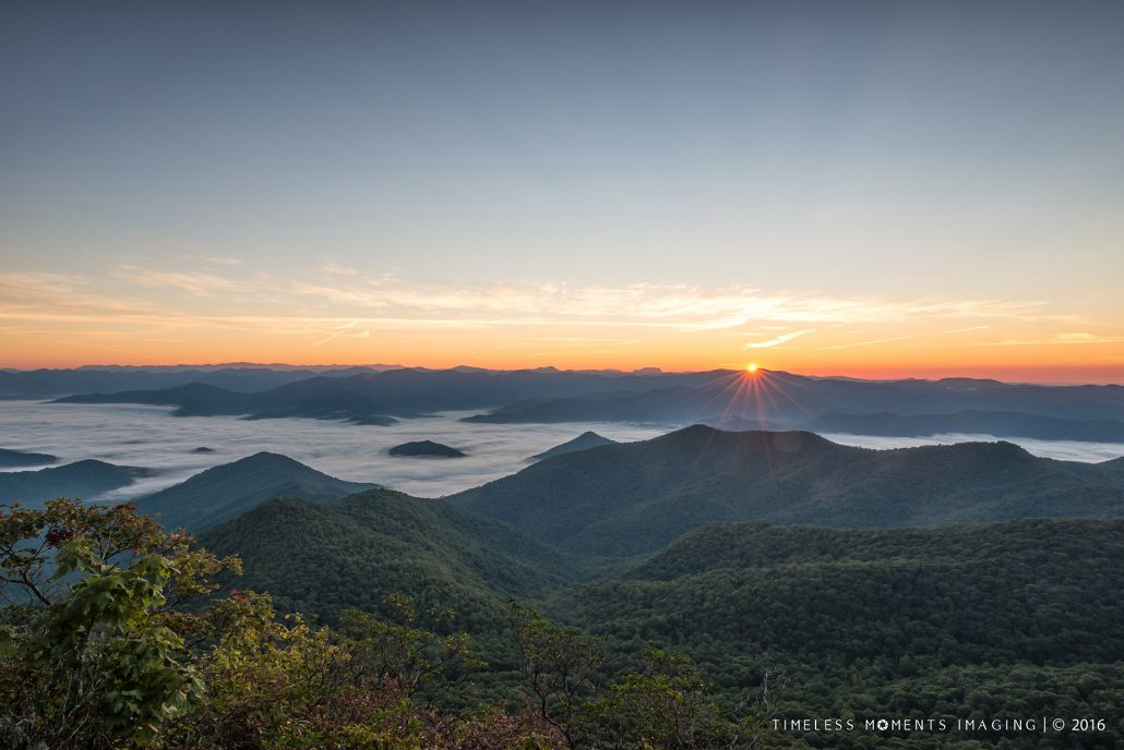 Sun rising from an out cropping on the Pickens Nose Trail, Franklin